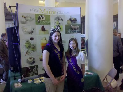 Maine Dairy Princesses in front of the Guild Booth at Ag Day at the Legislature